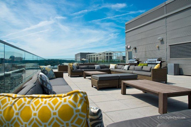 slide image Chill and grill on one of several roof deck social spaces.