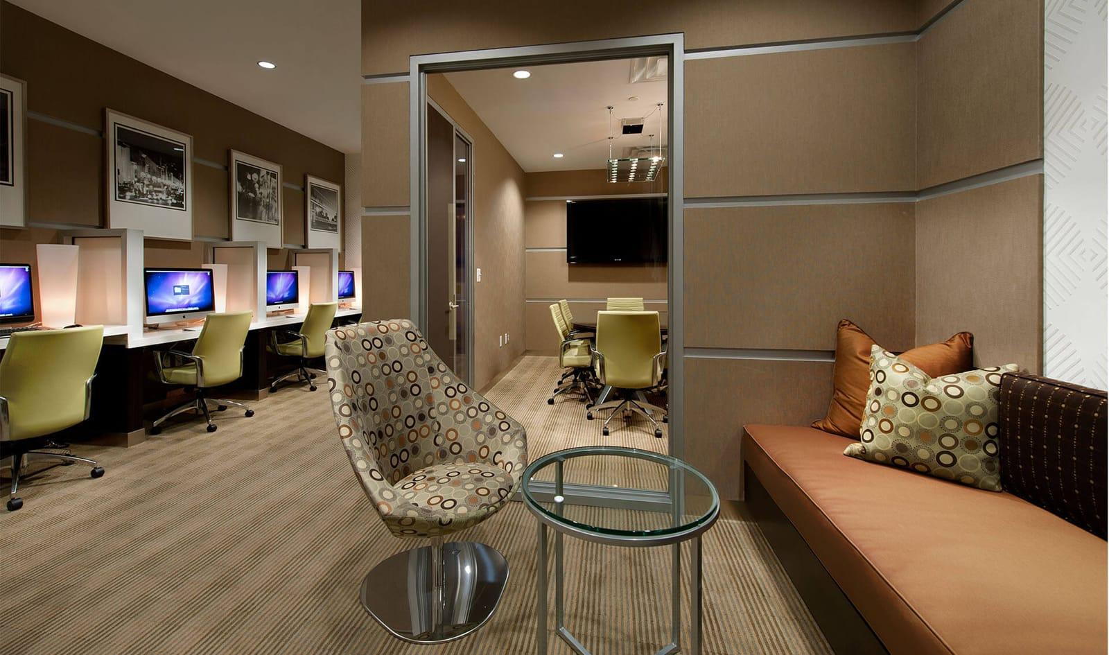 slide image The business center features Mac desktops and private conference room.<br />